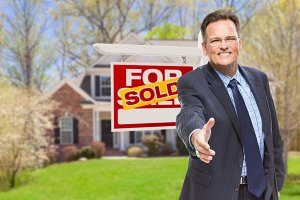 Agent with Hand Out & Sold Sign