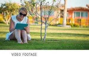 Beautiful woman sitting barefoot