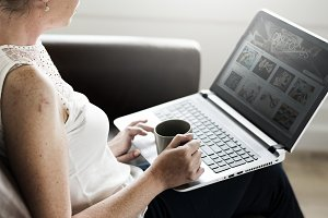 White woman using laptop at sofa
