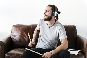 Caucasian man practicing drum