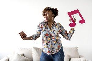 Woman enjoying music at home