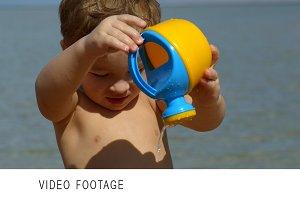 Little boy having fun with waterpot