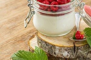 Glass jar with homemade yogurt and f