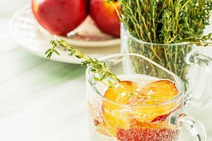 Sweet fizzy drink with peach slices