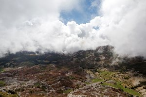 mountain view with thick clouds down to the lowland