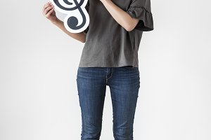 Woman holding a musical note icon