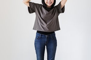 Happy Asian woman holding a smiley
