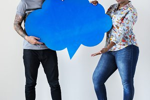 Couple holding speech bubble