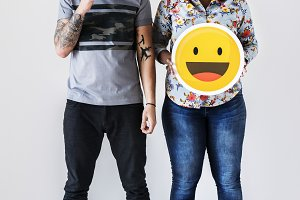 Couple holding emoticon face