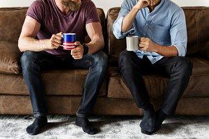 Men having morning coffee together