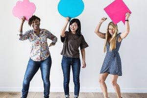Woman friends holding speech bubble