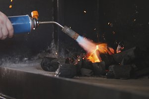 Ignition of charcoal in the barbecue oven