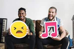 Friends holding emoticons
