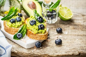 Sandwiches with avocado, blueberries