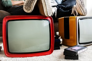 Two man sitting and retro television
