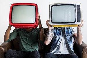 People holding retro television