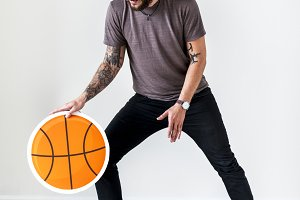 Man with tattoo playing basketball