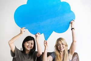 Women friends holding speech bubble