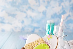 Easter cookies as egg in the wooden bowl with milk in glass on wood background