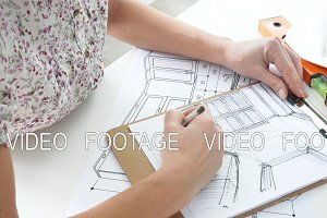 Woman drawing creative concept indoors. Student making a report on successful marketing.