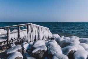 Frozen Dock at Baltic Sea in Winter