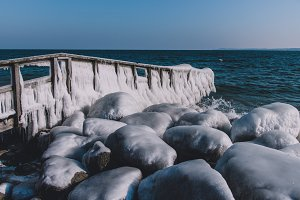 Frozen Dock and Rocks at Baltic Sea