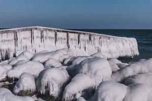 Frozen Dock with Rocks and Ocean