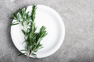 Empty plate with rosemary