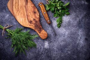 Dill, parsley and cutting board