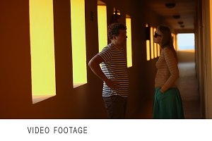 Talk in hotel corridor