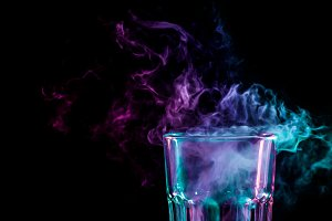 A glass with colorful smoke