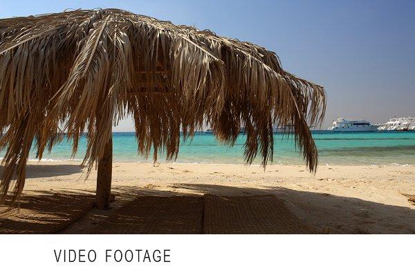 Straw beach umbrellas at a tropical