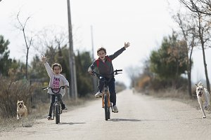 Two children who go with the bike