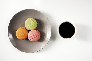 French cakes macaroons with coffee