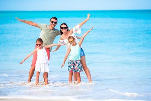 Young family on beach vacation have a lot of fun together