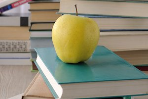 Apple on stack of books