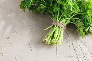 Parsley on concrete background