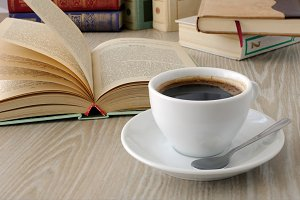 cup of coffee on a table with books
