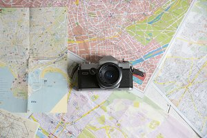 retro camera on the map, travel stuf