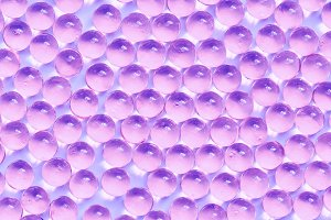Background of jelly capsules. Jelly round capsules of purple color.