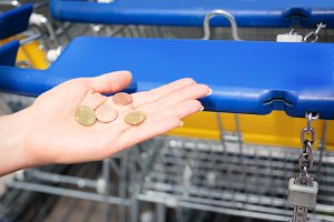 Customer Lacking The Right Coin Needed For A Shopping Cart