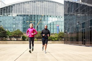 Multi-ethnic Couple Jogging In Urban Setting