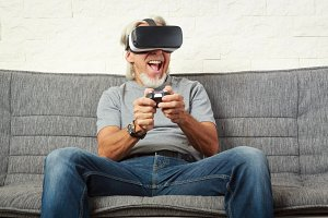 Senior Man On Couch, Playing Vr Game