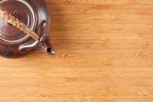 Tea Pot and Bamboo Textured Surface