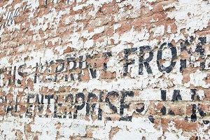 Ghost Writing Weathered Brick Wall