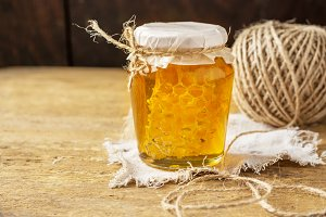 Fresh floral honey with honeycomb in a small glass