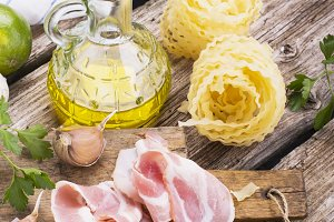 Ingredients for cooking fusilli pasta with bacon vegetables