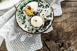 Quail eggs with a mixture of black and white salt