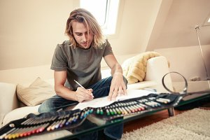 Young Man On Couch, Drawing In Coloring Book