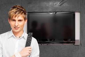 Young Man With Modern Tv Set